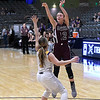 Garber's Ashlan Light shoots over Laverne's Ali Sparks during the consolation championship game of the Area 1 tournament Saturday, February 29, 2020 at the Stride Bank Center. (Billy Hefton / Enid News & Eagle)
