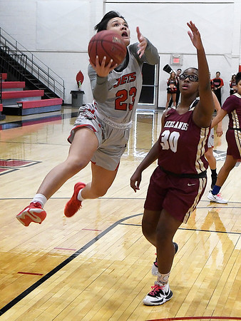 NOC Enid's Tanara Combs glides by Redlands' Kiara Lovings Thursday, February 20, 2020 at the NOC Mabee Center. (Billy Hefton / Enid news & Eagle)
