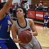 NOC Enid's Abby Phibbs drives to the basket against NEO's Gabriela Chivata Monday, February 10, 2020 at the NOC Mabee Center. (Billy Hefton / Enid News & Eagle)