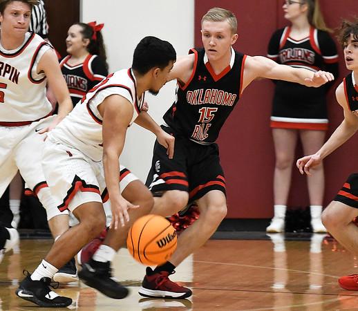 OBA's Nehemiah Noak defends Turpin's Cesar Anchondo during a regional basketball tournament Thursday, February 20, 2020 at Garber High School. (Billy Hefton / Enid news & Eagle)