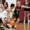OBA's Nehemiah Noak defends Turpin's Cesar Anchondo during a regional basketball tournament Thursday, February 20, 2020 at Garber High School. (Billy Hefton / Enid news & Eagle)