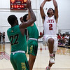 NOC Enid's Questyn Luckey puts up a shot against Western's Michael Mckay and David Labardy Thursday, February 27, 2020 at the NOC Mabee Center. (Billy Hefton / Enid News & Eagle)