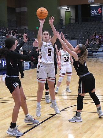 OBA's Sydney Winter puts up a shot between Watonga's Abby Boeckman and Karra Blackbear during the Downtown Basketball Festival Saturday, February 1, 2020 at the Stride Bank Center. (Billy Hefton / Enid News & Eagle)