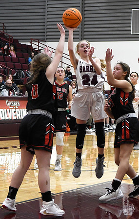 Garber's Alyssa Johnson shoots against OBA's Kamber Riffel and Alana White during the district championship game Saturday, February 15, 2020 at Garber High School. (Billy Hefton / Enid News & Eagle)