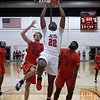 NOC Enid's Josh Perkins scores a break away dunk ahead of Seminole's Elijah Durham and Anthony Kinser Monday, February 3, 2020 at the NOC Mabee Center. (Billy Hefton / Enid news & Eagle)