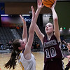 Garber's Grace Howry shoots over Laverne's Macy Bently during the consolation championship game of the Area 1 tournament Saturday, February 29, 2020 at the Stride Bank Center. (Billy Hefton / Enid News & Eagle)