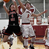 OBA's Jacob Wilson goes up against Turpin's Carson Buller during a regional basketball tournament Thursday, February 20, 2020 at Garber High School. (Billy Hefton / Enid news & Eagle)