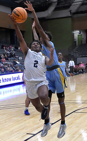 Enid's Telin Phillips goes up against Putnam City West's Malik Hearn Tuesday, February 4, 2020 at the Stride Bank Center. (Billy Hefton / Enid News & Eagle)
