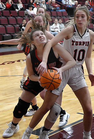 OBA's Harley Perdue tries to muscle the ball up against Turpin's Allison Weber during a regional basketball tournament Thursday, February 20, 2020 at Garber High School. (Billy Hefton / Enid news & Eagle)