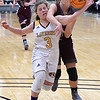 Garber's Katyryn Plunkett gets tangled with Laverne's Ali Sparks during the consolation championship game of the Area 1 tournament Saturday, February 29, 2020 at the Stride Bank Center. (Billy Hefton / Enid News & Eagle)