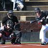 NOC Enid's Matthew Henderson lays down a bunt for a base hit against NE Nebraska Saturday, February 1, 2020 at David Allen Memorial Ballpark. (Billy Hefton / Enid News & Eagle)