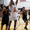 NOC Enid's Josh Perkins grabs a rebound away from Redlands' Carlos Coppage Thursday, February 20, 2020 at the NOC Mabee Center. (Billy Hefton / Enid news & Eagle)