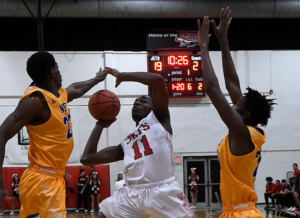 NOC Enid's Ikenna Okeke puts up a shot against NEO's Kalil Camara and Tyren Collins  Monday, February 10, 2020 at the NOC Mabee Center. (Billy Hefton / Enid News & Eagle)
