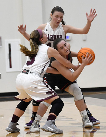 Garber's Kathryn Plunkett and Ashlan Light trap OBA's Cooper Cayot during the district championship game Saturday, February 15, 2020 at Garber High School. (Billy Hefton / Enid News & Eagle)