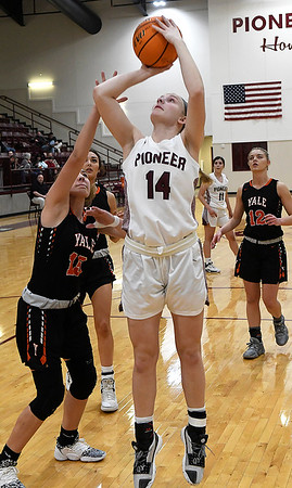 Pioneer's Kennedy Cassody shoots over Yale's Kinzey Ballard during a district tournament Friday, February 21, 2020 at Pioneer High School (Billy Hefton / Enid News & Eagle)