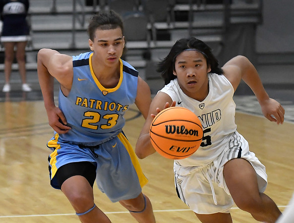 Enid's Jadon Dimarucut dribbles upcourt against pressure from Putnam City West's Daylon Andrews Tuesday, February 4, 2020 at the Stride Bank Center. (Billy Hefton / Enid News & Eagle)