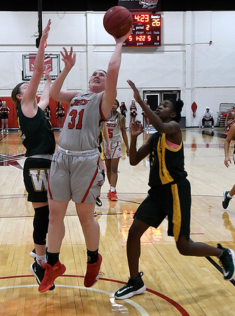 NOC Enid's Lauren Wade scores a basket between Western's Dejahnar Chatman and Tabitha Armstrong Thursday, February 27, 2020 at the NOC Mabee Center. (Billy Hefton / Enid News & Eagle)