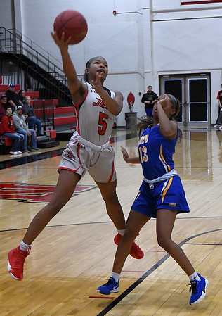 NOC Enid's Tonijah Fortune puts up a shot against NEO's Koreea Kirksey Monday, February 10, 2020 at the NOC Mabee Center. (Billy Hefton / Enid News & Eagle)