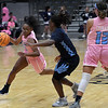 Enid's Lanie Goins (13) sets a pick as Mya Edwards drives towards the basket against Putnam City West's Sharonica Hartsfield Tuesday, February 4, 2020 at the Stride Bank Center. (Billy Hefton / Enid News & Eagle)