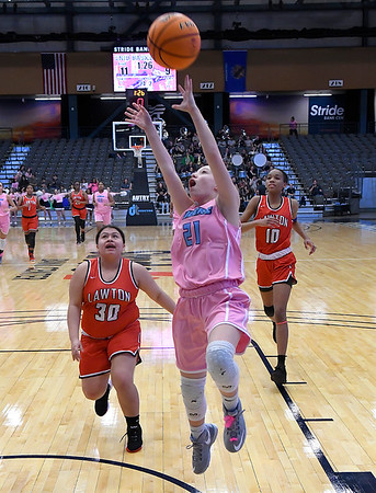Enid's Michelle Prince scores a fast break basket ahead of Lawton's Ellie Silverhorn and Maja Cullers Saturday February 8, 2020 at the Stride Bank Center. (Billy Hefton / Enid News & Eagle)