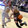 Garber's Alyssa Johnson drives pass Laverne's Macy Bently during the consolation championship game of the Area 1 tournament Saturday, February 29, 2020 at the Stride Bank Center. (Billy Hefton / Enid News & Eagle)