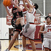 OBA's Jacob Wilson drives to the basket against Turpin's Aldo Espino during a regional basketball tournament Thursday, February 20, 2020 at Garber High School. (Billy Hefton / Enid news & Eagle)