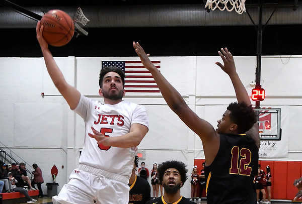 NOC Enid's Zach McDermott puts up a shot in the lane against Redlands' Latrell Marshall Thursday, February 20, 2020 at the NOC Mabee Center. (Billy Hefton / Enid news & Eagle)