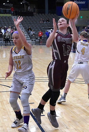Garber's Ashlan Light puts up a twisting shot against Laverne's Katelin Long during the consolation championship game of the Area 1 tournament Saturday, February 29, 2020 at the Stride Bank Center. (Billy Hefton / Enid News & Eagle)