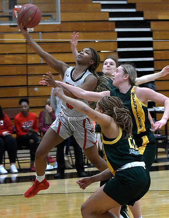 NOC Enid's Tonijah Fortune scores a basket ahead of a trio of Western defenders Thursday, February 27, 2020 at the NOC Mabee Center. (Billy Hefton / Enid News & Eagle)