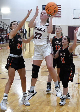 Pioneer's Erin Faw Faw gets off a shot in the lane while surrounded Yale's Joey Armstrong, Grace Richards and Sylvia Skinner during a district tournament Friday, February 21, 2020 at Pioneer High School (Billy Hefton / Enid News & Eagle)