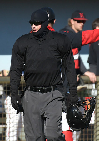 The home plate umpire dressed for the weather as he called the NOC Enid v Rose State game Tuesday, February 18, 2020 at David Allen Memorial Ballpark. (Billy Hefton / Enid News & Eagle)