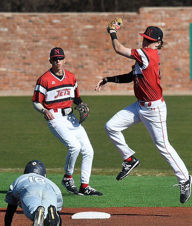 NOC Enid Ambren Voitik comes down with a high throw to tag out Rose State's Dalton Schwartz Tuesday, February 18, 2020 at David Allen Memorial Ballpark. (Billy Hefton / Enid News & Eagle)