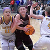 Garber's Ashlan Light tries to drive between Laverne's Katelin Long and Jade Bently during the consolation championship game of the Area 1 tournament Saturday, February 29, 2020 at the Stride Bank Center. (Billy Hefton / Enid News & Eagle)