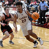 Garber's Tydonte Chester drives pass OBA's Jett Cheatham during the district championship game Saturday, February 15, 2020 at Garber High School. (Billy Hefton / Enid News & Eagle)