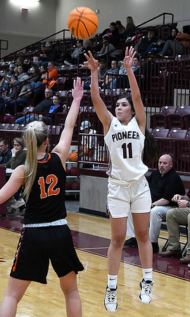 Pioneer's Crystal De La Torre shoots over Yale's Sylvia Skinner during a district tournament Friday, February 21, 2020 at Pioneer High School (Billy Hefton / Enid News & Eagle)