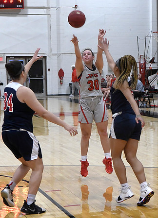 NOC Enid's Madelyn Hankins shoots over Seminole's Kailah Ballou and Kamiyah Lyons Monday, February 3, 2020 at the NOC Mabee Center. (Billy Hefton / Enid news & Eagle)