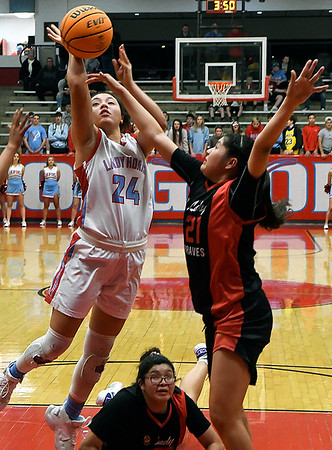 Chisholm's Tatum Long puts up a shot against Riverside's Taygen Marshall during a district tournament game at Chisholm High School Saturday, February 22, 2020. (Billy Hefton / Enid News & Eagle)