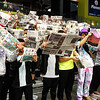 Hydro-Eakly student use newspapers to show their disinterest in Garber's starting line-up during the championship game of the Area 1 tournament Friday, February 28, 2020 at the Stride Bank Center. (Billy Hefton / Enid News & Eagle)