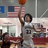 Garber's Daegan Vandiver scores a basket against OBA's Jacob Wilson during the district championship game Saturday, February 15, 2020 at Garber High School. (Billy Hefton / Enid News & Eagle)