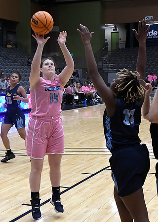 Enid's Mary Ketterman shoots over against Putnam City West's Akile Stone Tuesday, February 4, 2020 at the Stride Bank Center. (Billy Hefton / Enid News & Eagle)