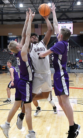 Garber's Ty Chester muscles up a shot against Hydro-Eakly's Paxton Price and Nolan Gore during the championship game of the Area 1 tournament Friday, February 28, 2020 at the Stride Bank Center. (Billy Hefton / Enid News & Eagle)