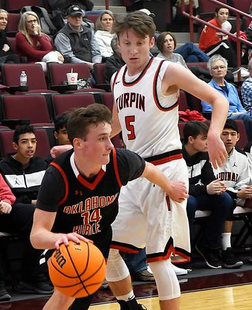 OBA's JJett Cheatham drives by Turpin's Carson Buller during a regional basketball tournament Thursday, February 20, 2020 at Garber High School. (Billy Hefton / Enid news & Eagle)