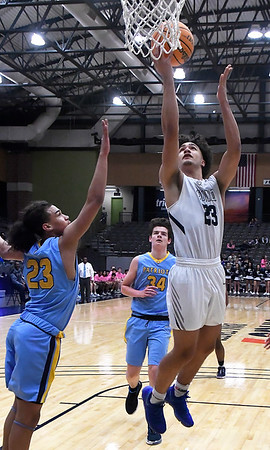 Enid's Cater Owens scores against Putnam City West's Daylon Andrews Tuesday, February 4, 2020 at the Stride Bank Center. (Billy Hefton / Enid News & Eagle)