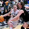 OBA's Clara Caldwell drives towards the basket against Watonga's Cacie Gorman during the Downtown Basketball Festival Saturday, February 1, 2020 at the Stride Bank Center. (Billy Hefton / Enid News & Eagle)