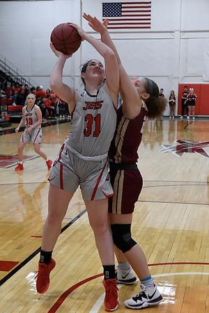 NOC Enid's Lauren Wade puts up a shot over Redlands' Karyssa Jackson Thursday, February 20, 2020 at the NOC Mabee Center. (Billy Hefton / Enid news & Eagle)