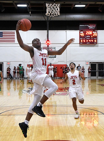 NOC Enid's Ikenna Okeke scores a break away basket against Western Thursday, February 27, 2020 at the NOC Mabee Center. (Billy Hefton / Enid News & Eagle)