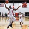 NOC Enid's Ikenna Okeke scores a break away basket against Western Thursday, February 27, 2020 at the NOC Mabee Center. (Billy Hefton / Enid News & Eagle)