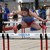 Chisholm's Molly Burchel runs the 55 meter hurdles during the Fifteenth Annual Track and Field Games at the Chisholm Trail Expo Center Saturday, February 15, 2020. (Billy Hefton / Enid News & Eagle)