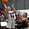 Garber's Alyssa Johnson shoots over OBA's Alana White during the district championship game Saturday, February 15, 2020 at Garber High School. (Billy Hefton / Enid News & Eagle)