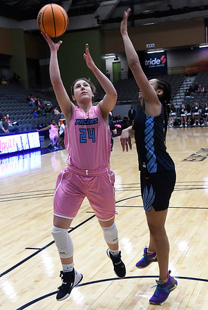 Enid's Claire Dodds puts up a shot against Putnam City West's Zaniya Nelson Tuesday, February 4, 2020 at the Stride Bank Center. (Billy Hefton / Enid News & Eagle)